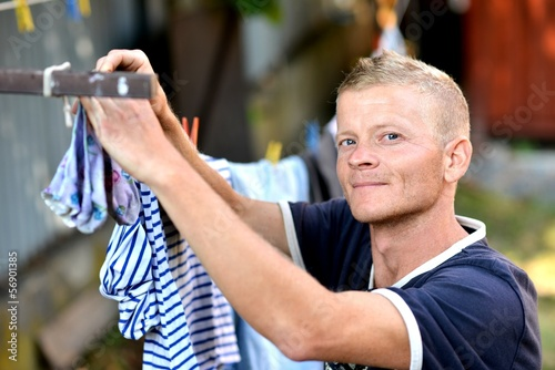Man hanging laundry to dry