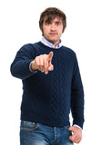 Handsome man in sweater pointing  his finger