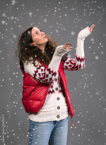 Woman in warm clothing with snow