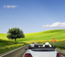 Travelling in a white convertible