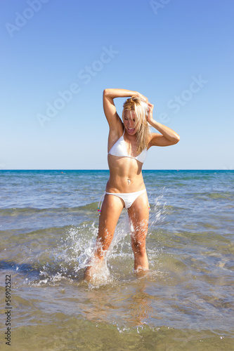Woman in bikini in the sea