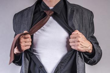 young businessman pulls shirt
