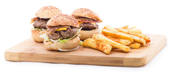 Three different types of hamburgers with french fries isolated