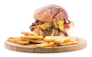 Cheese steak burger with french fries on the side isolated