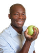 African man eating an apple