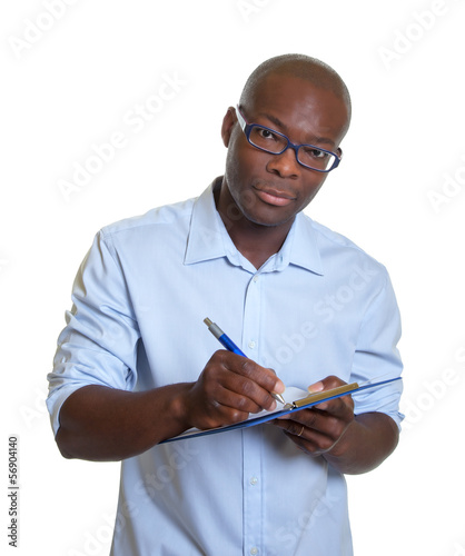 African businessman with clipboard