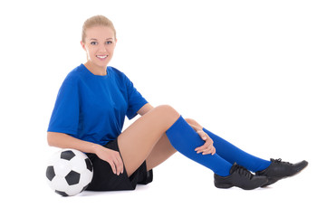 female soccer player in blue uniform sitting with ball isolated