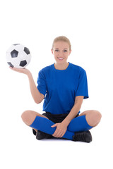 young female soccer player in blue uniform sitting with ball iso