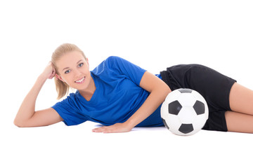 young female soccer player in blue uniform lying with ball isola