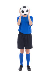 woman in blue holding soccer ball in front of her face