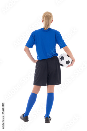 back view of female soccer player in blue uniform with ball isol