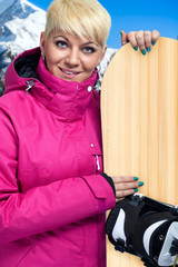 portrait of woman with snowboard
