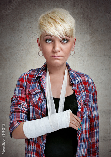 sad girl with a broken arm