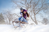 couple sledging through