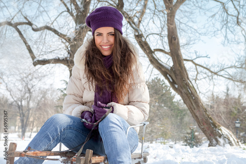 Young girl on sleigh