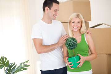 Young attractive couple in new home