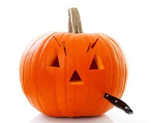 Cutting face out of pumpkin