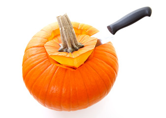Knife is cutting in pumpkin