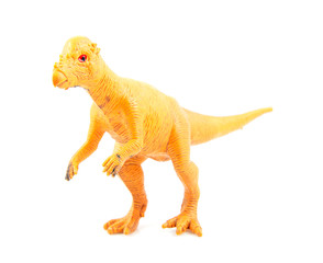 Yellow plastic dinosaur toy