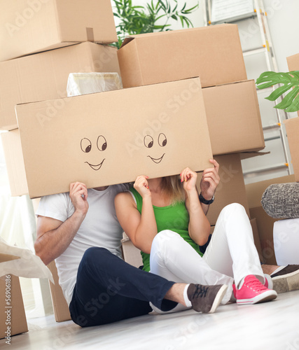 couple having fun in their new house