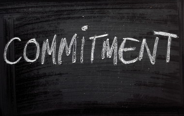 The word Commitment on a Blackboard