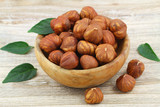 Whole hazelnuts without shell in wooden bowl