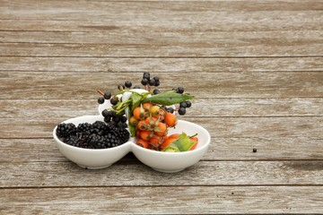 Small salad bowl with autumn fruits