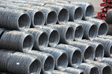 Stacked steel wire roll and pipe, ready for shipment in port