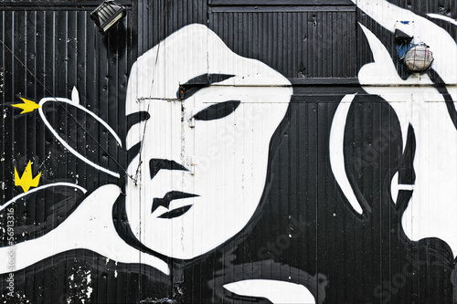 Woman face graffiti on a doorway