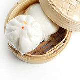 Chinese steamed buns in bamboo basket