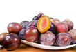 fresh plums on wooden table
