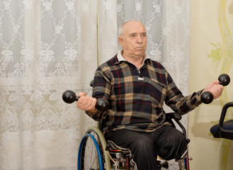 Senior handicapped man doing exercises