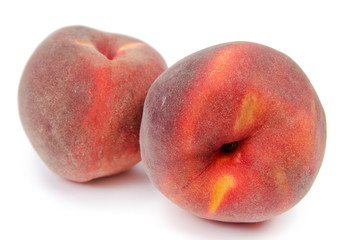 Close up of a two ripe peaches