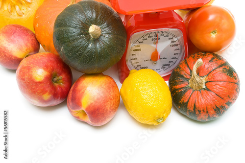 Vegetables, fruits and kitchen scales close-up. white background