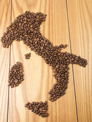 Italy map with Coffee beans on the wood table