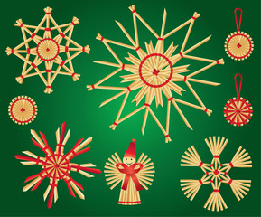 christmas straw decorations on green background