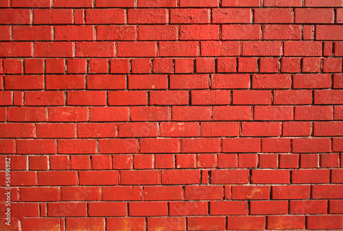 Red brick wall as background front view closeup