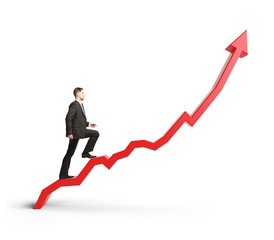 businessman climbing a red graph arrow