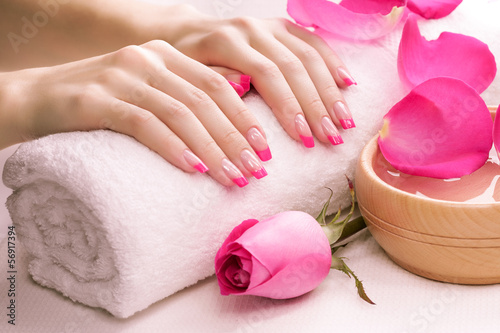 pink manicure with towel. Spa