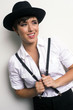 Young Androgynous Woman Stands Wearing Hat Suspenders White