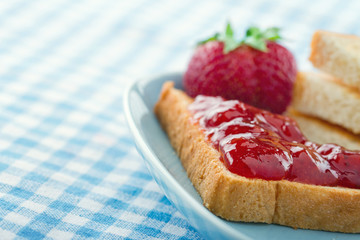 Bread with red strawberry jam