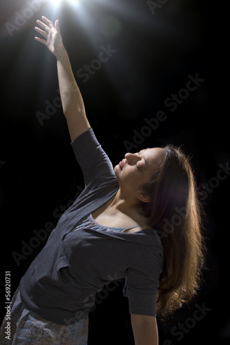 young woman is being taken by a UFO by levitation Poster