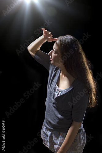 young woman seeing bright glowing orbs from above Poster