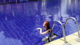 woman swims in pool