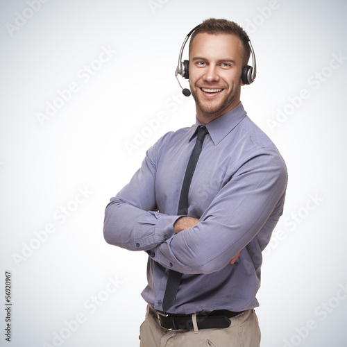 smiling man wearing a headset