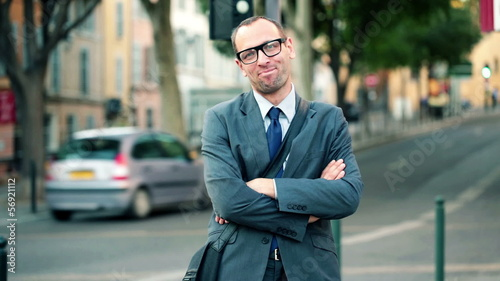 Portrait of young successful confident businessman in the city
