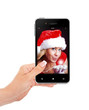 hand holding mobile phone with christmas woman isolated over whi
