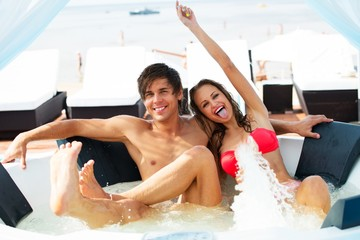 Sexy young couple relaxing in a jacuzzi