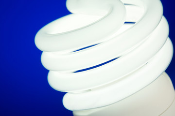 Eco Light Bulb on Blue Background
