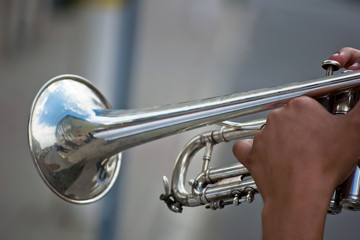 man playing the silver trumpet